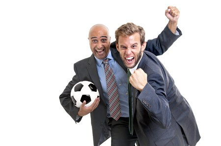 Businessmen with soccer ball posing