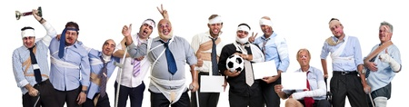 violence in sports: Team of injured and happy businessmen after a soccer game Stock Photo