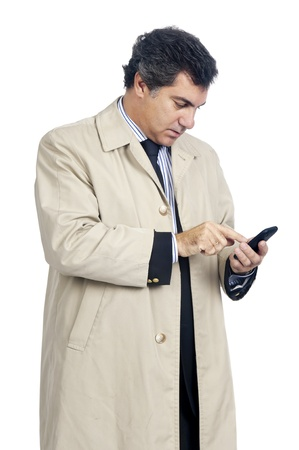 Young businessman with cellphone isolated in white photo