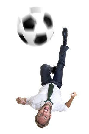 fairplay: Businessman with soccer ball in acrobatic kick Stock Photo