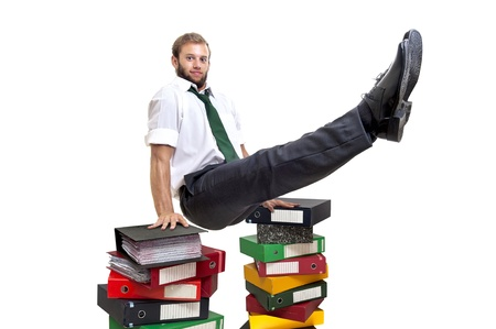 compete: Businessman doing exercices over stack of files