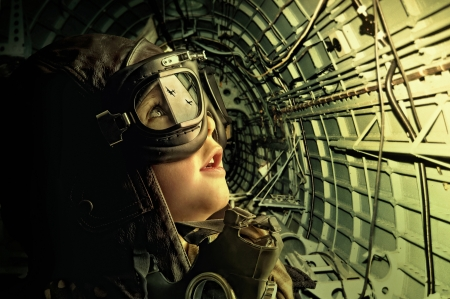 Young aviator looking at enemy planes