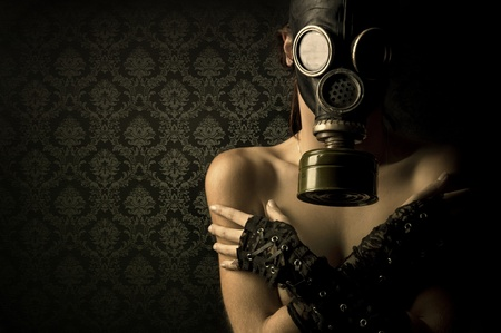 Woman with gas mask in a grunge background photo