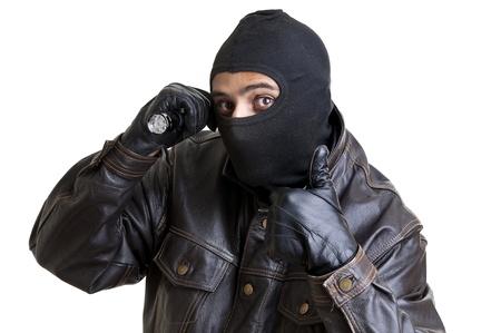 Burglar with flashlight isolated in white Stock Photo - 12071724