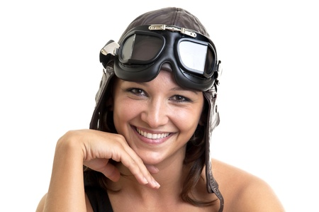 Beautiful young woman with pilot hat and goggles photo