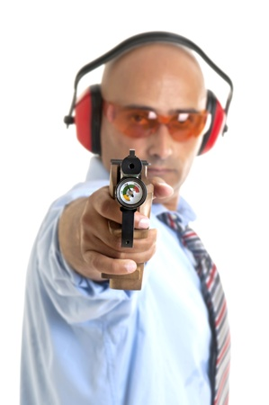 Businessman with compressed air gun  photo