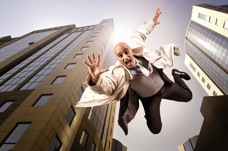 Businessman falling from a tall building photo