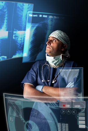 Doctor in uniform with X-rays and digital  screens and keyboard Stock Photo