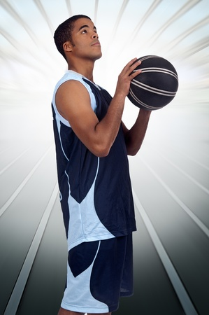Basketball player ready to throw photo