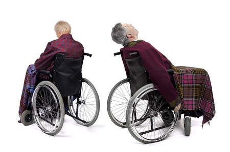 Lonely male elderlies in  wheelchairs Stock Photo - 12581276