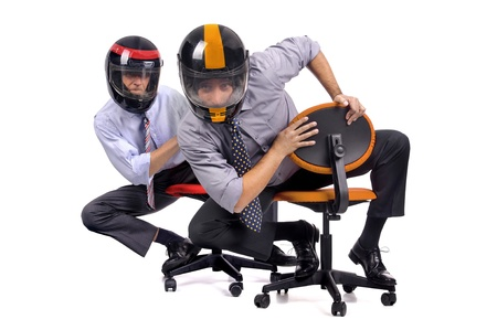 executive helmet: Businessmen racing in chairs with helmets