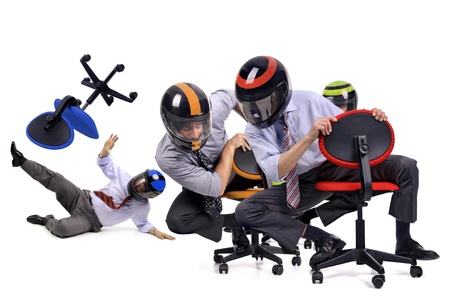 motorcycle accidents: Businessmen racing in chairs with helmets