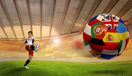 Soccer player kicking a ball with Euro cup nations flags photo