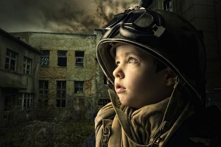 war crimes: Young boy alone  in a war zone