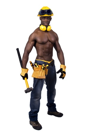 Strong build black construction worker with big hammer isolated in white Stock Photo - 12581459