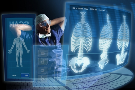 doctor computer: Doctor in uniform with X-rays and digital  screens and keyboard Stock Photo
