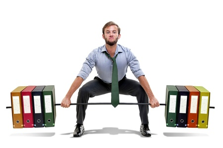 powerlifting: Muscular businessman lifting weights made of heavy files