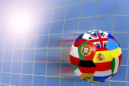 Euro cup soccer ball with flags over a goals net Stock Photo