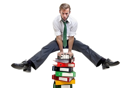 Businessman doing exercices over stack of files