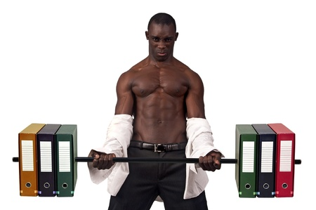Strong businessman  lifting weights made of heavy files photo