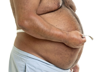 gluttonous: Large man belly with measuring tape isolated in white