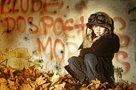 world wars: Young boy in a war zone crying for help Stock Photo