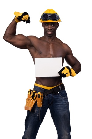 Strong build black construction worker with a white card isolated in white photo