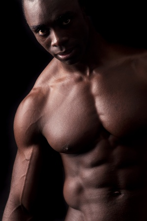 Beautiful and muscular black man in dark background Stock Photo - 12962383