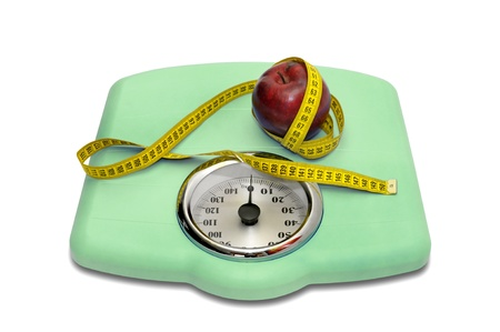 Weight scale with measuring tape and apple Stock Photo - 12962326