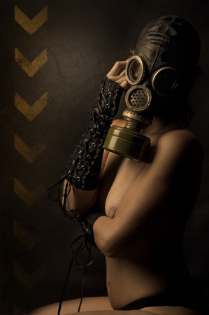 protective wear: Woman with gas mask in a grunge background Stock Photo