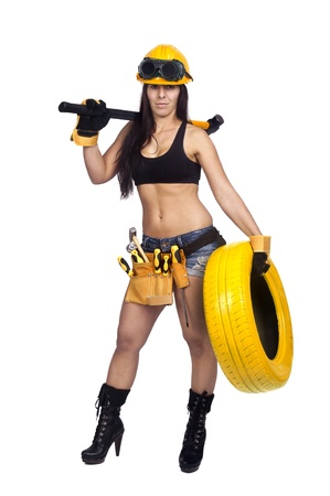 Sexy worker posing against a white background with tires photo