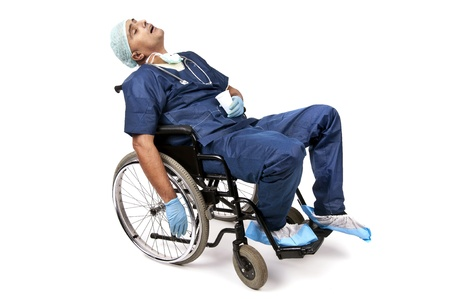 resting mask: Tired doctor sleeping in a wheelchair