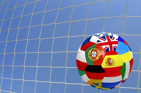 Euro cup soccer ball with flags over a goals net photo