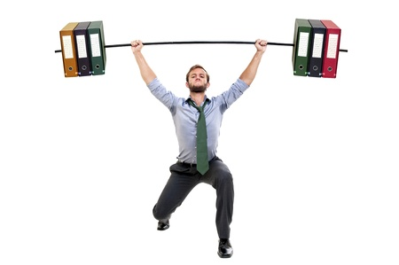 Muscular businessman lifting weights made of heavy files photo