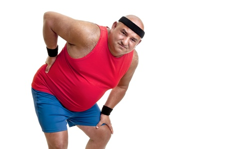Large and tired fitness man with back pain isolated in white