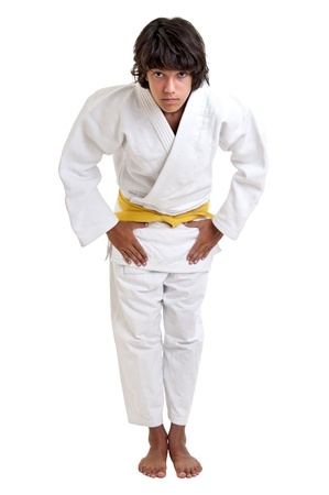arts: Young fighter posing against a white background