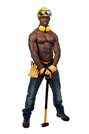 plumber tools: Strong build black construction worker with big hammer isolated in white