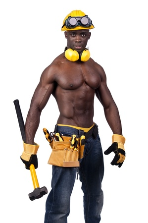 Strong build black construction worker with big hammer isolated in white photo