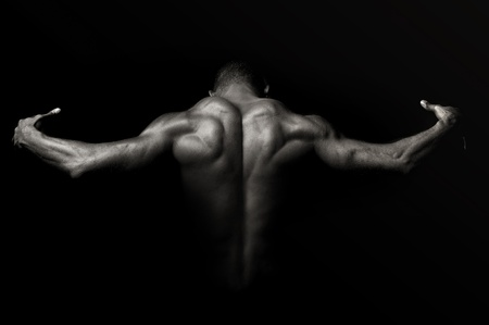 fitness model: Beautiful and muscular black mans back in dark background Stock Photo
