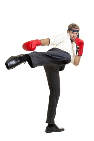 businessman ready to fight with boxing gloves photo