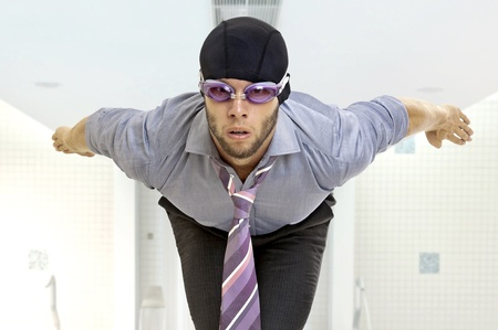 Businessman with swimming gear in a pool photo