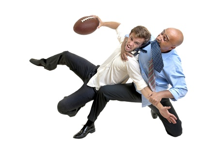Businessmen playing rugby isolated in white photo