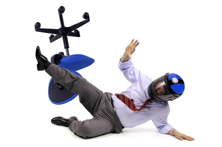 Businessman racer crashing in a chair with helmet photo