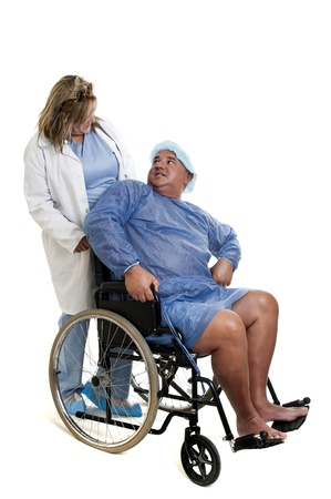 Large male patient in a wheelchair with doctor photo