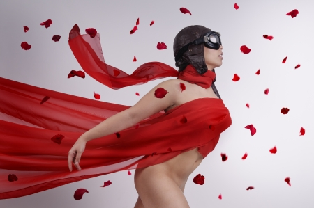 Beautiful girl with helmet and goggles and red veil photo