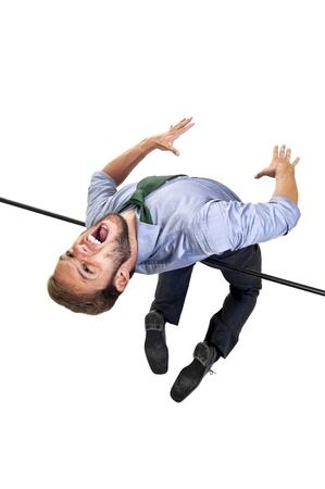 jumping businessman: Businessman jumping over an Olympic high-jump bar