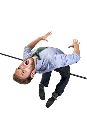 Businessman jumping over an sports competition high-jump bar