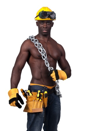 Strong build black construction worker with chains isolated in white photo