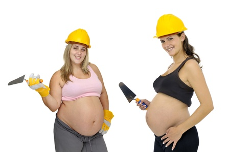 Pregnant women with construction  helmet  isolated in white photo