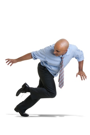 Businessman running against a white background photo